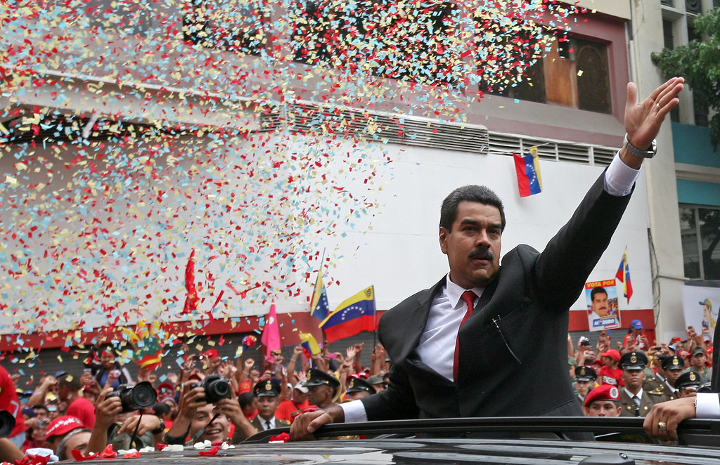 . venezuela\'s President-elect Nicolas Maduro waves to supporters as he arrives at the national Assembly for his inaugural ceremony in Caracas, Venezuela, Friday, April 19, 2013. The opposition boycotted the swearing-in ceremony, hoping that the ruling party\'s last-minute decision to allow an audit of nearly half the vote could change the result in a the bitterly disputed presidential election. (AP Photo/Gil Montano)