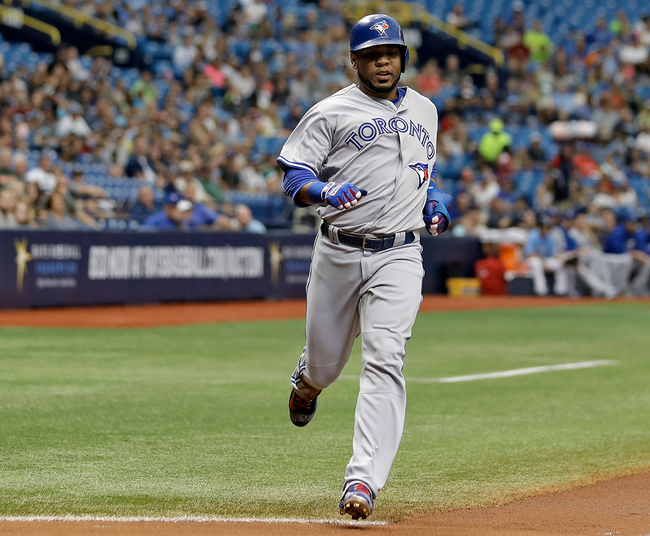 . Toronto Blue Jays\' Edwin Encarnacion scores on an RBI single by Dioner Navarro off Tampa Bay Rays starting pitcher Chris Archer during the first inning of a baseball game Sunday, Sept. 4, 2016, in St. Petersburg, Fla.  (AP Photo/Chris O\'Meara)
