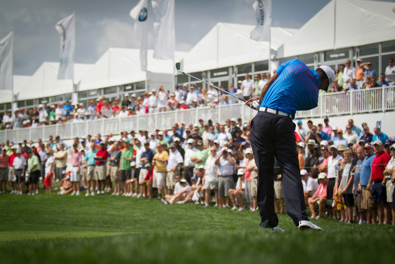 Tiger Woods hits out of the rough on the 14th hole during first round action at the BMW Championship at Crooked Stick CC in Carmel Indiana on Thursday Sept. 6, 2012. (Charles Cherney/WGA)