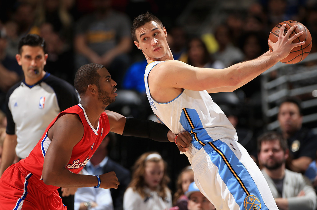 . DENVER, CO - MARCH 07:  Danilo Gallinari #8 of the Denver Nuggets controls the ball against Chris Paul #3 of the Los Angeles Clippers at the Pepsi Center on March 7, 2013 in Denver, Colorado. (Photo by Doug Pensinger/Getty Images)