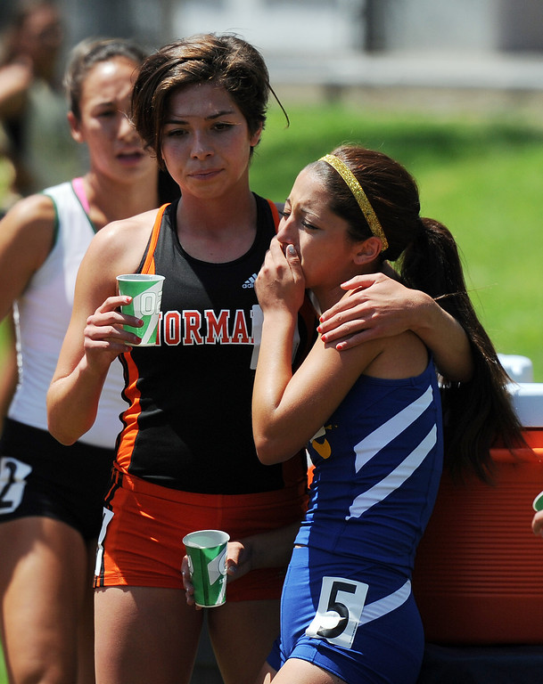 . Bishop Amat\'s Emily Hubert reacts after the 1600 meters race during the CIF-SS track & Field championship finals in Hilmer Stadium on the campus of Mt. San Antonio College on Saturday, May 18, 2013 in Walnut, Calif.  (Keith Birmingham Pasadena Star-News)