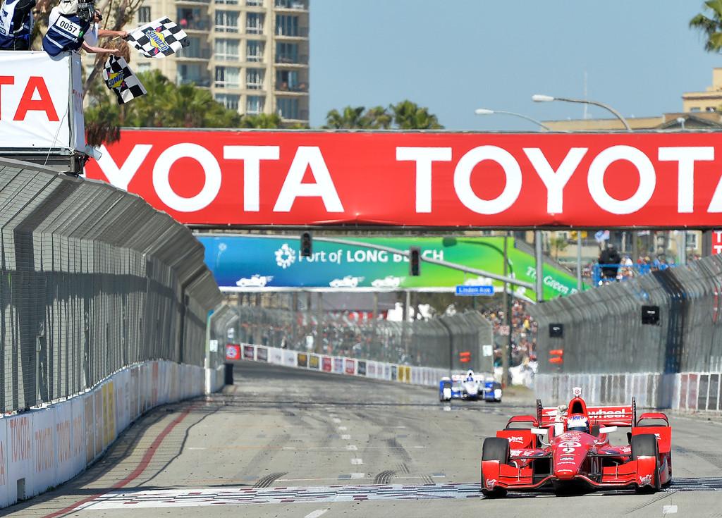 . Scott Dixon comes across the fiish line to win theToyota Grand Prix of Long Beach in Long Beach CA. Sunday April 19, 2015.  (Thomas R. Cordova-Daily Breeze/Press-Telegram)