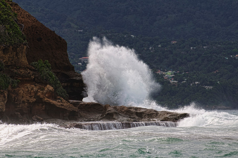 The waves slam into the rocky point.