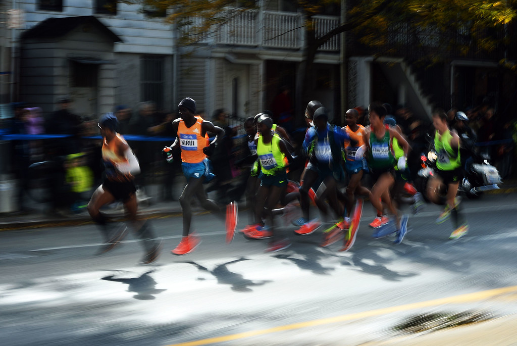 . Runners compete in the New York City Marathon on November 2, 2014. Kenya\'s Wilson Kipsang won the New York City Marathon men\'s title, defeating Ethiopia\'s Lelisa Desisa with a strong push to the finish line. Kipsang won the 26.2-mile race in an unofficial time of two hours, 20 minutes and 59 seconds with Desisa four seconds back. AFP PHOTO/Jewel SamadJ