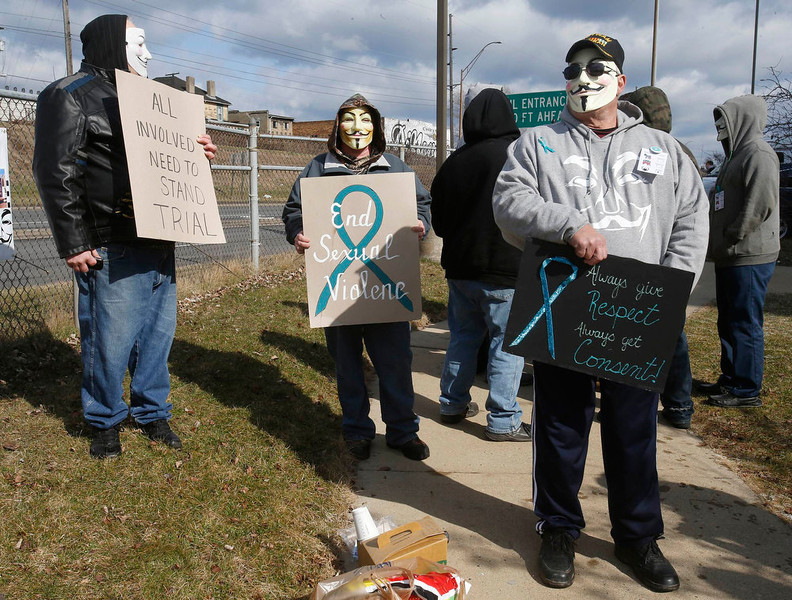 . A group of protesters stand outside juvenile court in Steubenville, Ohio, March 14, 2013. Trent Mays, 17, and Ma\'lik Richmond, 16, are on trial accused of raping a drunk classmate as she lay naked on a basement floor, too drunk to move or speak. REUTERS/Jason Cohn