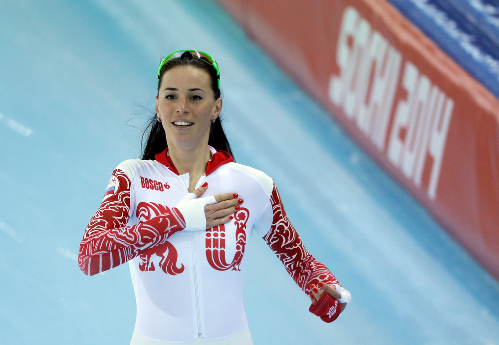 . Russia\'s Yekaterina Lobysheva greets cheering fans after her second heat race for the women\'s 500-meter speed skating at the Adler Arena Skating Center during the 2014 Winter Olympics, Tuesday, Feb. 11, 2014, in Sochi, Russia. (AP Photo/David J. Phillip )
