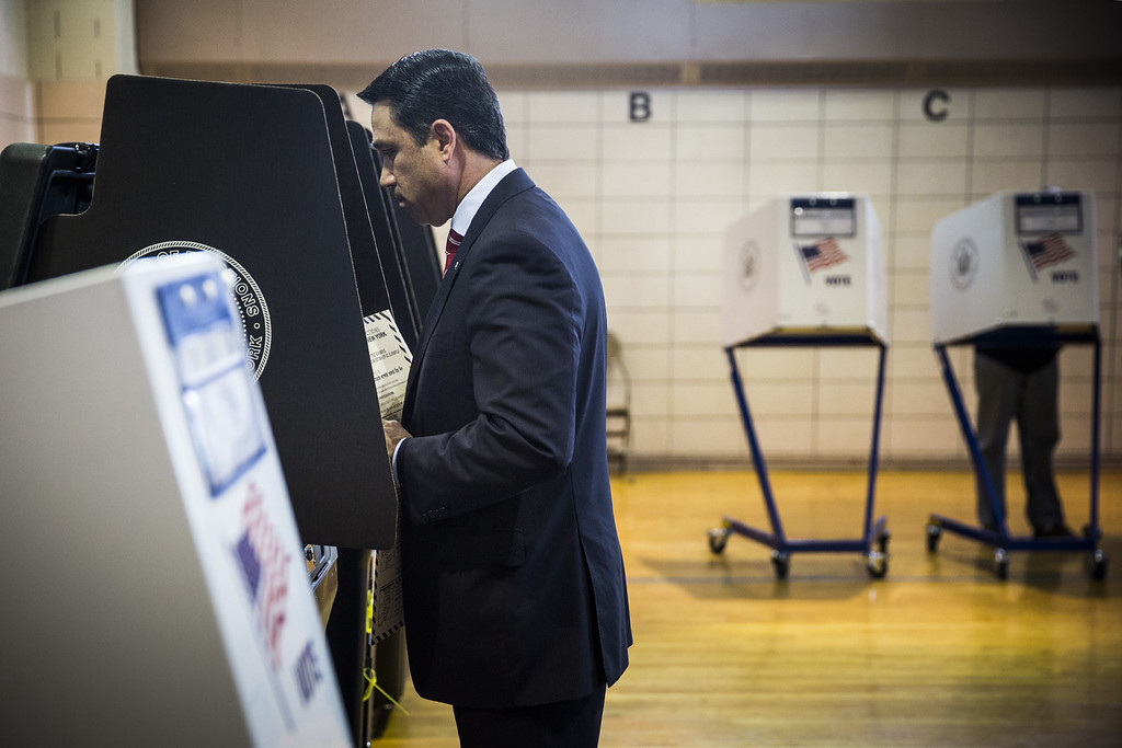. New York Rep. Michael Grimm (R-Staten Island/Brooklyn) casts his ballot at a voting station on November 4, 2014 in the Staten Island borough of New York City. Grimm is facing a 20-count federal indictment relating to alleged illegal fundraising. Voters across the nation are going to the polls today to vote in various political races at the local, state and national level.  (Photo by Andrew Burton/Getty Images)