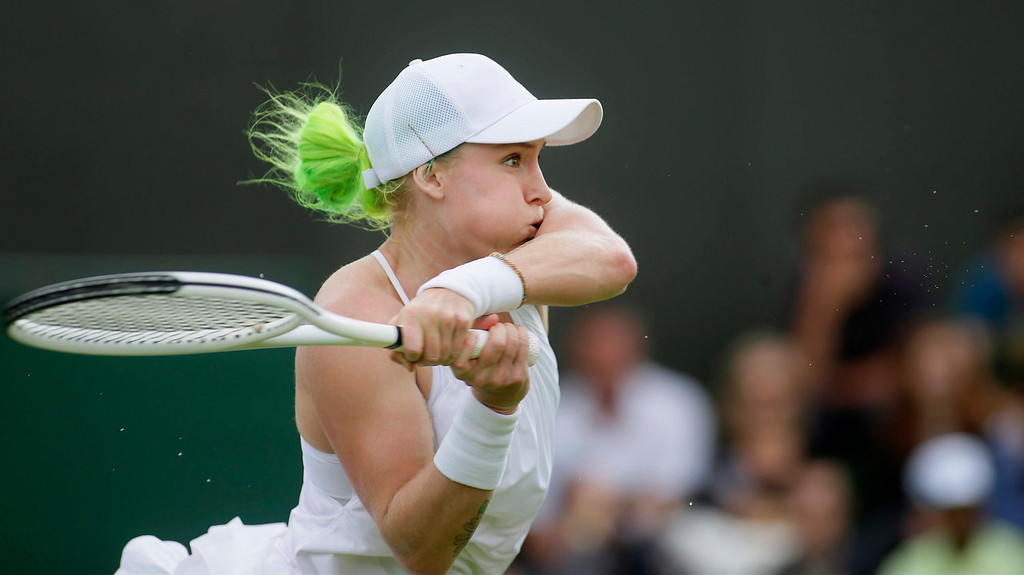 . Bethanie Mattek-Sands of the United States returns the ball to Angelique Kerber of Germany during their Women\'s first round singles match at the All England Lawn Tennis Championships in Wimbledon, London, Tuesday, June 25, 2013.  (AP Photo/Alastair Grant)