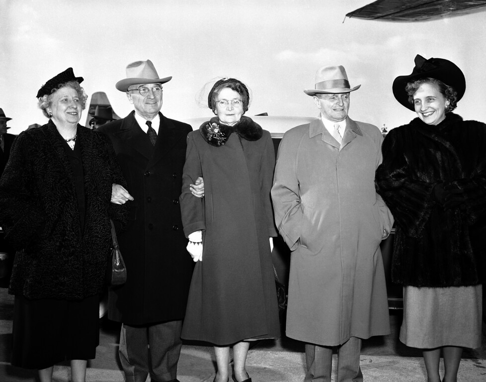 . President Harry S. Truman poses with four members of his family at the Kansas City, Missouri Municipal Airport before boarding his plane for Washington, Dec. 26, 1950 to cut short his Christmas stay in Missouri. Left to right are: Bess Truman; the president; Jane Truman, Grandview, Mo., his sister; J. Vivian Truman, also of Grandview, his brother; and his daughter, Margaret. The chief executive left a day ahead of schedule for a conference with cabinet members in the capitol. (AP Photo)