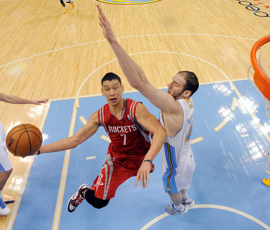 . Nuggets center Kosta Koufos, right, tries to block Houston Rockets point guard Jeremy Lin (7) during the fourth quarter on January 30, 2013 at Pepsi Center.    (Photo By John Leyba/The Denver Post)