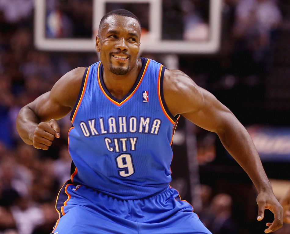 . Serge Ibaka #9 of the Oklahoma City Thunder reacts after a play in the first quarter against the San Antonio Spurs during Game Five of the Western Conference Finals of the 2014 NBA Playoffs at AT&T Center on May 29, 2014 in San Antonio, Texas.   (Photo by Ronald Martinez/Getty Images)