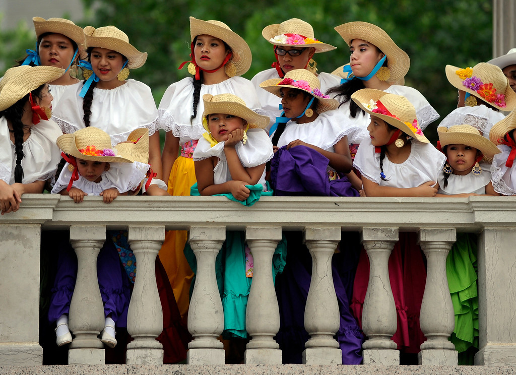 . The Colorado Mestizo Dancers waited for their turn to perform Thursday night. Denver celebrated Mexico Night in Civic Center Park Thursday night, July 18, 2013. The event was part of the Biennial of the Americas which is billed as an international festival of ideas, art, and culture. Photo By Karl Gehring/The Denver Post