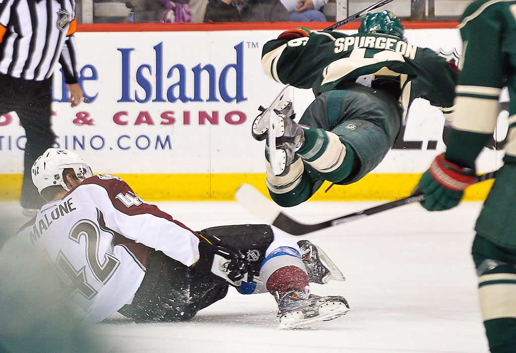. Minnesota Wild defenseman Jared Spurgeon is airborne after being tripped by Colorado Avalanche center Brad Malone during the third period. (Pioneer Press: Ben Garvin)