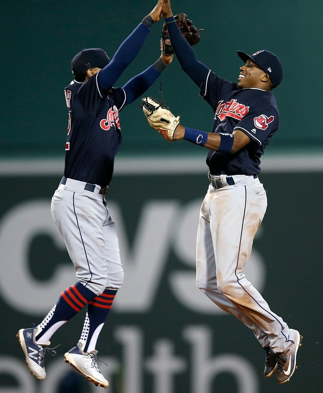 . Cleveland Indians\' Greg Allen, right, and Francisco Lindor celebrate after defeating the Boston Red Sox during a baseball game in Boston, Tuesday, Aug. 21, 2018. (AP Photo/Michael Dwyer)