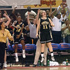 The Farmville Central HIgh School womens basketball team erupts on the sideline after a last-second, nail-biter win in the 2A West Womens High School State Championship at Reynolds Coliseum in Raleigh, NC.