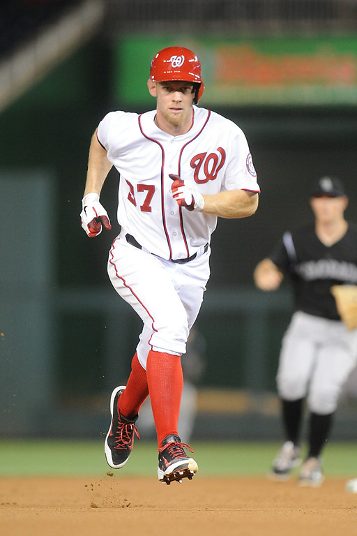 . Stephen Strasburg #37 of the Washington Nationals runs to third base in the seventh inning during a baseball against the Colorado Rockies on July 1, 2014 at Nationals Park in Washington, DC.  The Nationals won 7-1. (Photo by Mitchell Layton/Getty Images)