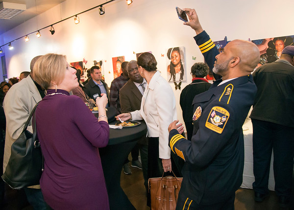 02/28/20 Wesley Bunnell | StaffrrTwenty five men were honored at Gallery 66 on Friday night for their involvement in the community as part of Black History Month. CCSu Police Chief Gregory B. Sneed takes a photo of the crowd.