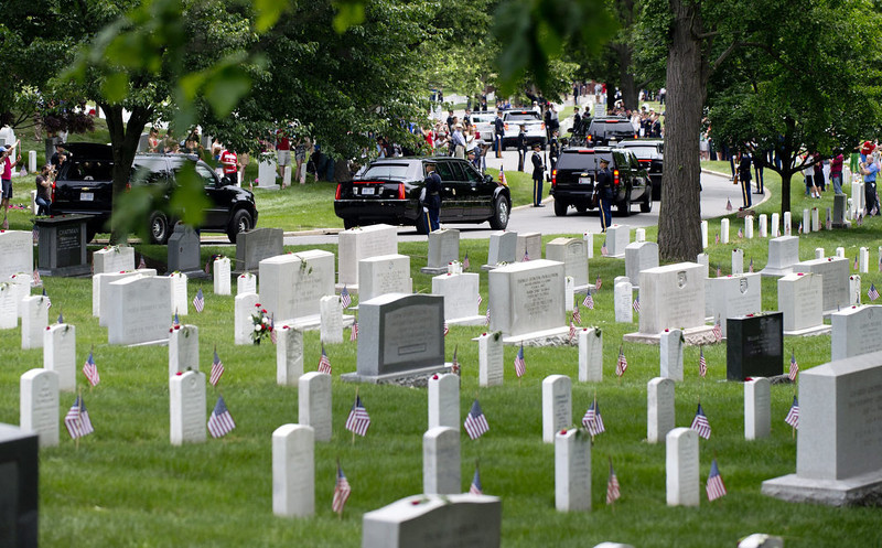 . US President Barack Obama\'s motorcade drives past grave markers after he spoke in honor of Memorial Day at Arlington National Cemetery in Arlington, Virginia, May 27, 2013.  SAUL LOEB/AFP/Getty Images