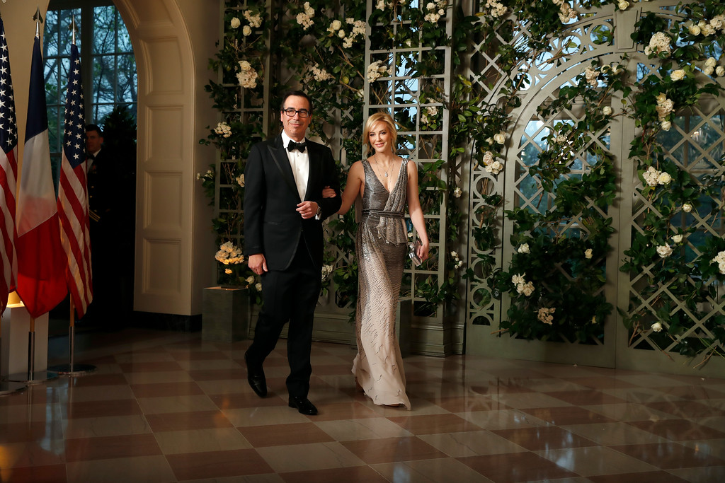 . Treasury Secretary Steve Mnuchin and his wife Louise Linton arrive for a State Dinner with French President Emmanuel Macron and President Donald Trump at the White House, Tuesday, April 24, 2018, in Washington. (AP Photo/Alex Brandon)