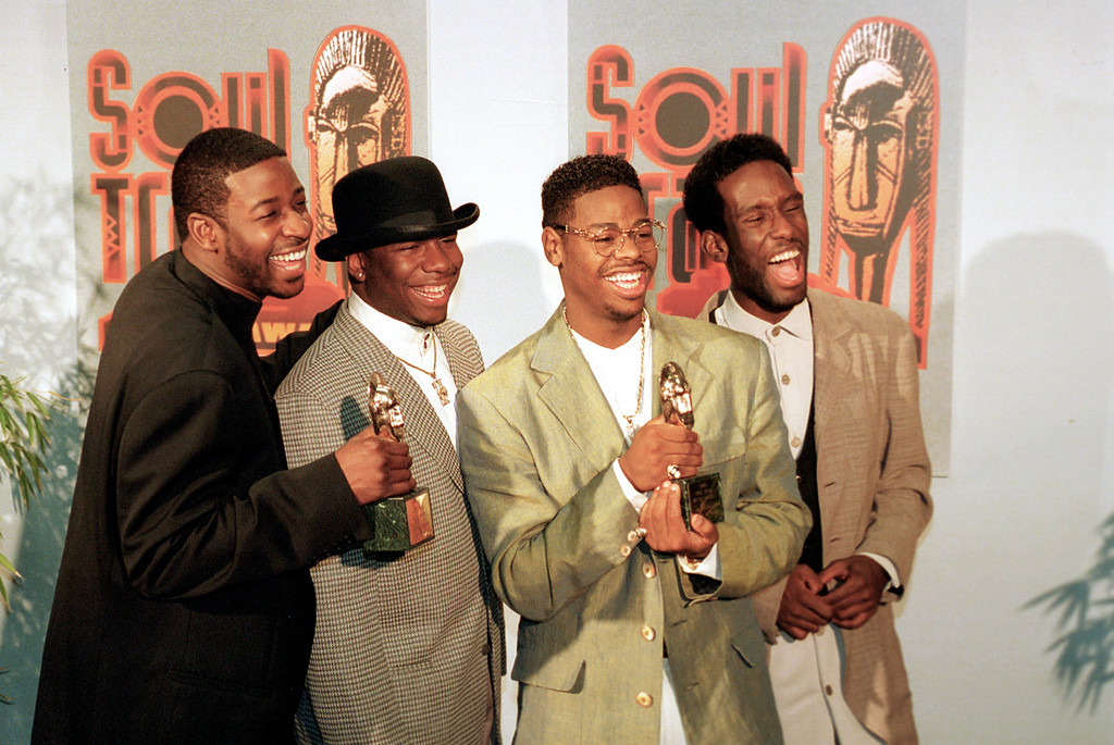 . The group Boyz II Men display their two awards backstage at the Soul Train Music Awards in Los Angeles, Ca., Monday, March 13, 1995. The group won for best rhythm and blues single, group, band or duo; and for best rhythm and blues album, group. The members, from left, are, Michael McCary, Wanya Morris, Nate Morris and Shawn Stockman. (AP Photo/Eric Draper)