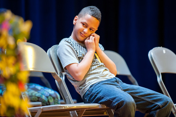 04/25/18 Wesley Bunnell | Staff The Consolidated School District of New Britain held its District Middle School Spelling Bee Championship at Slade Middle School on Wednesday evening. 7th grader Jazavier Figueroa from Pulaski Middle School glances over at the judges table during the competition.