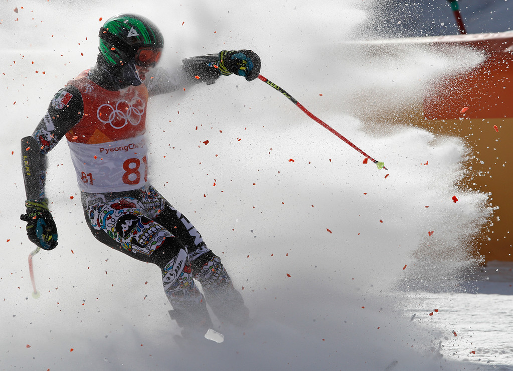 . Mexico\'s Rodolfo Roberto Dickson Sommers completes the first run of the men\'s giant slalom at the 2018 Winter Olympics in Pyeongchang, South Korea, Sunday, Feb. 18, 2018. (AP Photo/Christophe Ena)