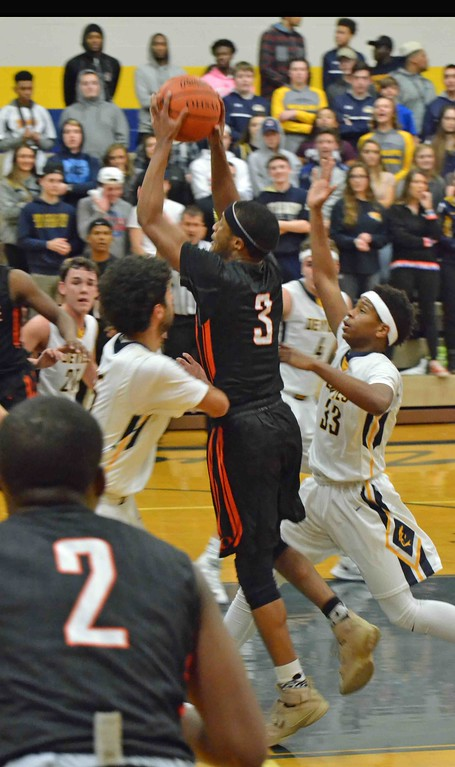 . Paul DiCicco - The News-Herald Orange�s Jalen Warren drives to the basket against Wickliffe.