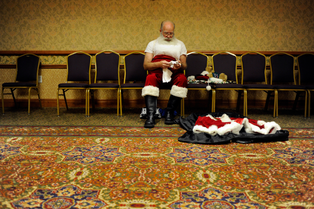 Description of . Santa Claus gets his uniform ready during a Santa Claus School graduation ceremony at the Red Lion Inn on Monday, September 5, 2011. AAron Ontiveroz, The Denver Post