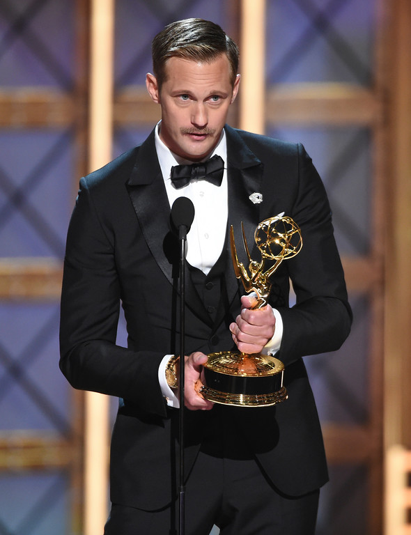 ". Alexander Skarsgard accepts the award for outstanding supporting actor in a limited series or a movie for ""Big Little Lies\"" at the 69th Primetime Emmy Awards on Sunday, Sept. 17, 2017, at the Microsoft Theater in Los Angeles. (Photo by Phil McCarten/Invision for the Television Academy/AP Images)"