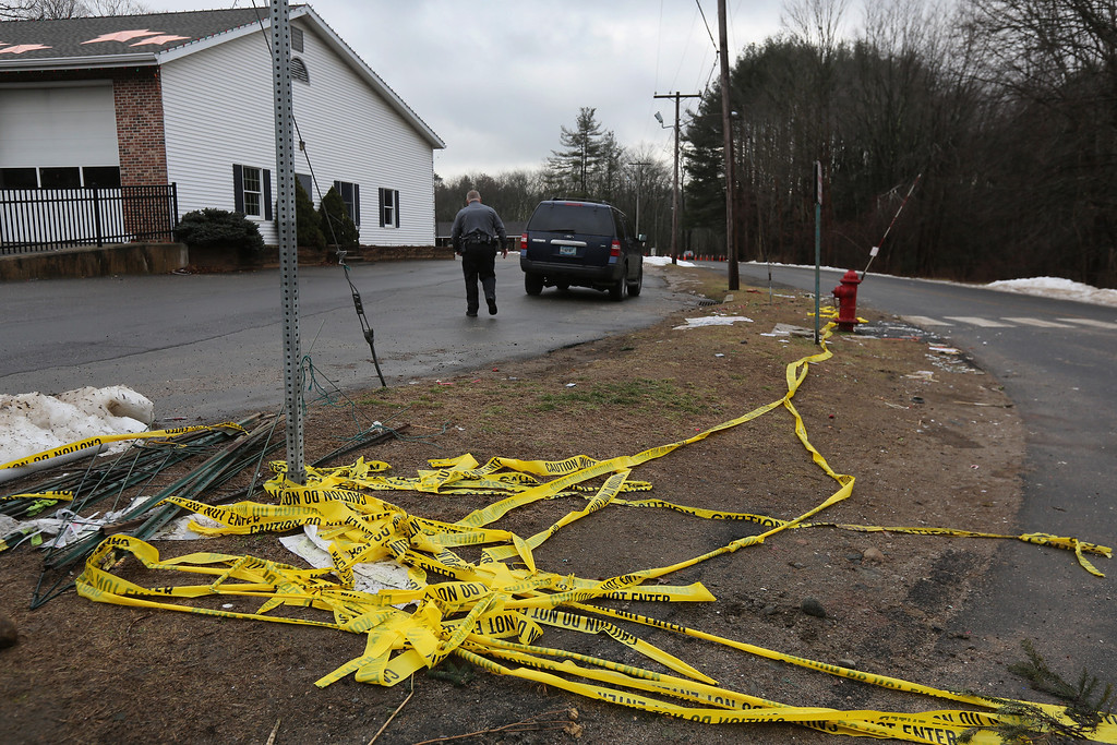 . Police tape lies bunched near the road to Sandy Hook Elementary School on January 14, 2013 in Newtown, Connecticut. The town marked a month anniversay since the massacre of 26 children and adults at the school, the second-worst such shooting in U.S. history.  (Photo by John Moore/Getty Images)