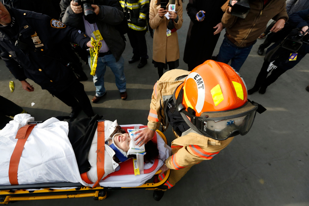 Description of . A victim of a commuter ferry crash is cared for by an FDNY EMT on the scene in New York, January 9, 2013. A commuter ferry crashed into a pier in lower Manhattan early Wednesday, injuring 57 people, one critically, the New York City Police Department said. Passengers lying on stretchers littered the pier near South Street Seaport, attended to by firefighters and rescue workers who rushed to the scene of the 8:43 a.m. (1343 GMT) hard landing. REUTERS/Brendan McDermid
