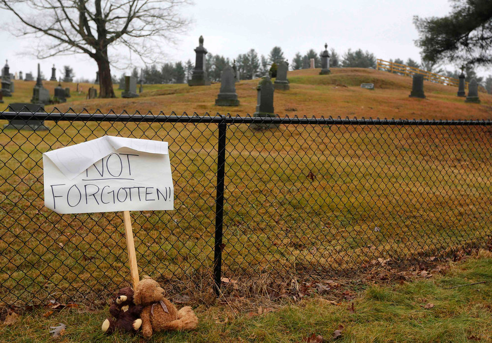 . A sign is seen outside the St. Rose Cemetery in Sandy Hook, Connecticut December 18, 2012. Twelve girls, eight boys and six adult women were killed in a shooting on Friday at Sandy Hook Elementary School in Newtown.    REUTERS/Shannon Stapleton