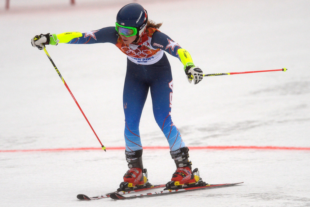 Description of . U.S.A. skier Mikaela Shiffrin crosses the line during the first round of the ladies' giant slalom. Sochi 2014 Winter Olympics on Tuesday, February 18, 2014. (Photo by AAron Ontiveroz/The Denver Post)
