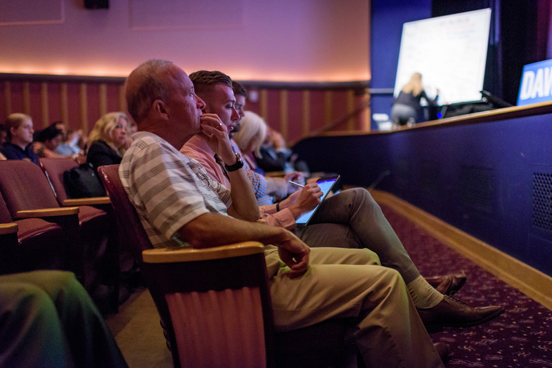 Purdue President Mitch Daniels watches Vanderbilt University professor Michael Bess speak during the first day of the Dawn Or Doom conference in Fowler Hall. (Purdue University Photo/Alex Kumar)