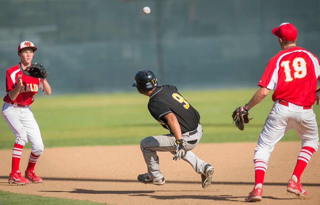 . Santa Fe High\'s Tony Oliveras is run down in a second inning pickle after trying to steal second base vs Whittier Christian High at Biola University\'s field in La Mirada March 12, 2013.  (SGVN/Staff photo by Leo Jarzomb)
