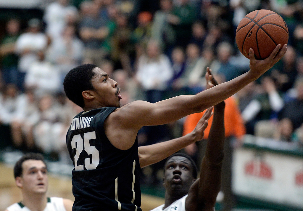 . CU\'s Spencer Dinwiddie drives to the hoop to score in front of Joe De Ciman, at right, and J.J. Avila, at left, during an NCAA game against CSU on Tuesday, Dec. 3, 2013, at the Moby Arena in Fort Collins. Jeremy Papasso/ Camera