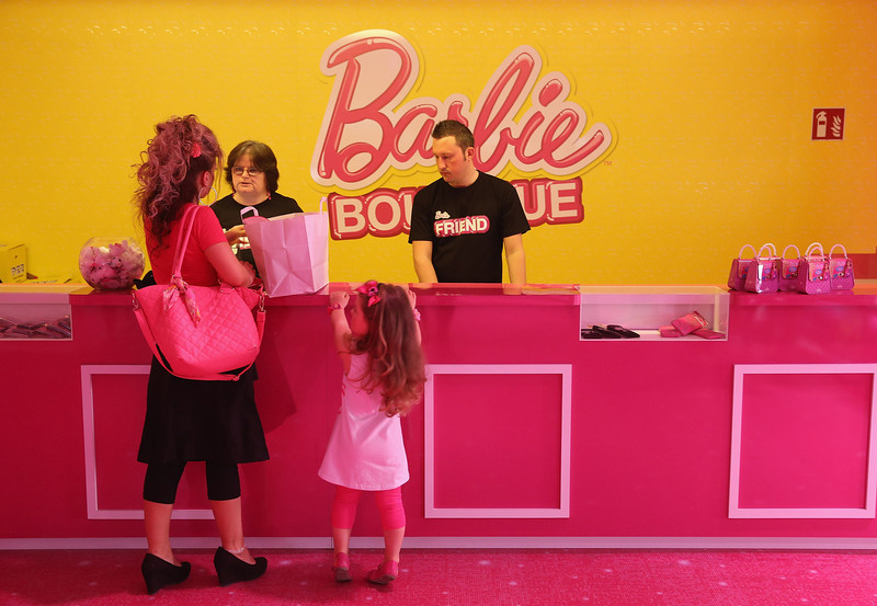 . Selina, 3, and her mother Doreen purchase souvenirs at the merchandising shop at the Barbie Dreamhouse Experience with her mother on May 16, 2013 in Berlin, Germany. The Barbie Dreamhouse is a life-sized house full of Barbie fashion, furniture and accessories and will be open to the public until August 25 before it moves on to other cities in Europe.  (Photo by Sean Gallup/Getty Images)