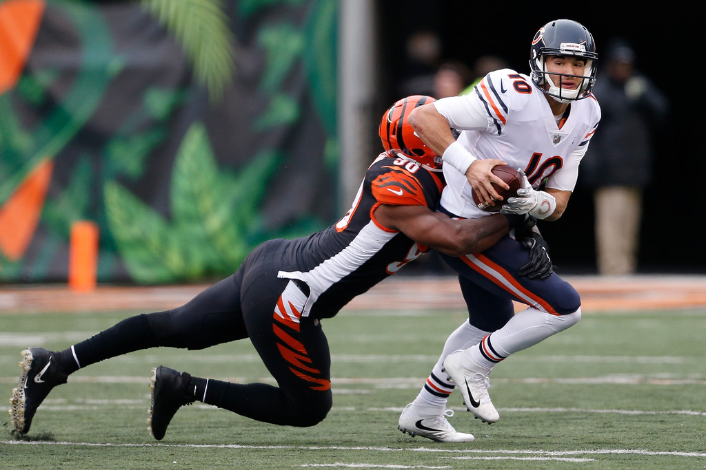 . Chicago Bears quarterback Mitchell Trubisky (10) is tackled by Cincinnati Bengals defensive end Michael Johnson (90) in the second half of an NFL football game, Sunday, Dec. 10, 2017, in Cincinnati. (AP Photo/Gary Landers)