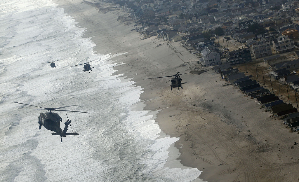. Four Air Force Black Hawk helicopters, one with Vice President Joe Biden onboard, approaches Seaside Park, N.J., Sunday, Nov. 18, 2012. The Vice President is in New Jersey to tour the damage and thank first responders from Superstorm Sandy. (AP Photo/Rich Schultz)
