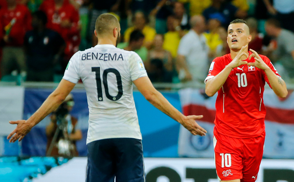 . Switzerland\'s Granit Xhaka, right, celebrates after scoring his side\'s second goal during the group E World Cup soccer match between Switzerland and France at the Arena Fonte Nova in Salvador, Brazil, Friday, June 20, 2014. (AP Photo/David Vincent)