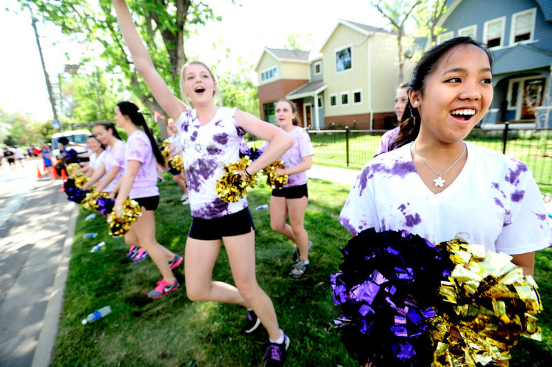 . Nora O\'Neil and Emily Weber of the Boulder High School Poms entertain the runners during the 2013 Bolder Boulder in Boulder Colorado.  Photo by Paul Aiken / The Boulder Daily Camera / May 27, 2013