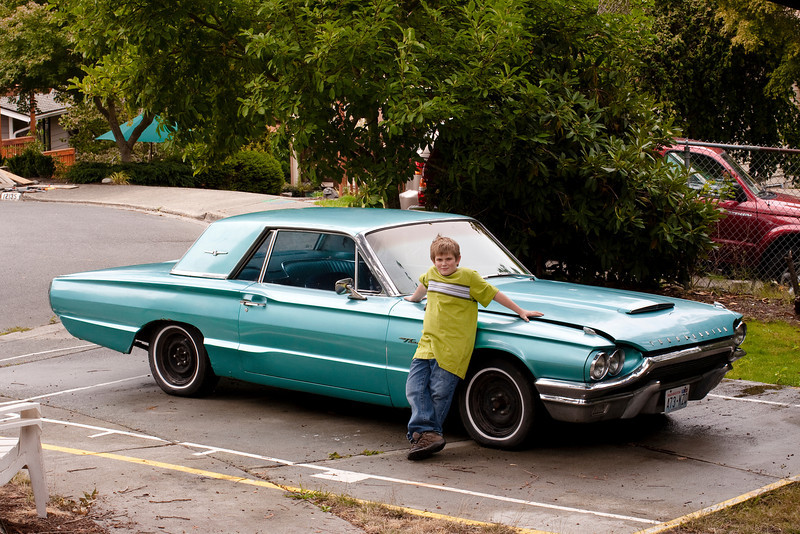 Here is the classic shot. Nate and his 64 tbird. Feeling fine and looking cool! I can't wait to take this picture again when he's 16 and the car is finished!