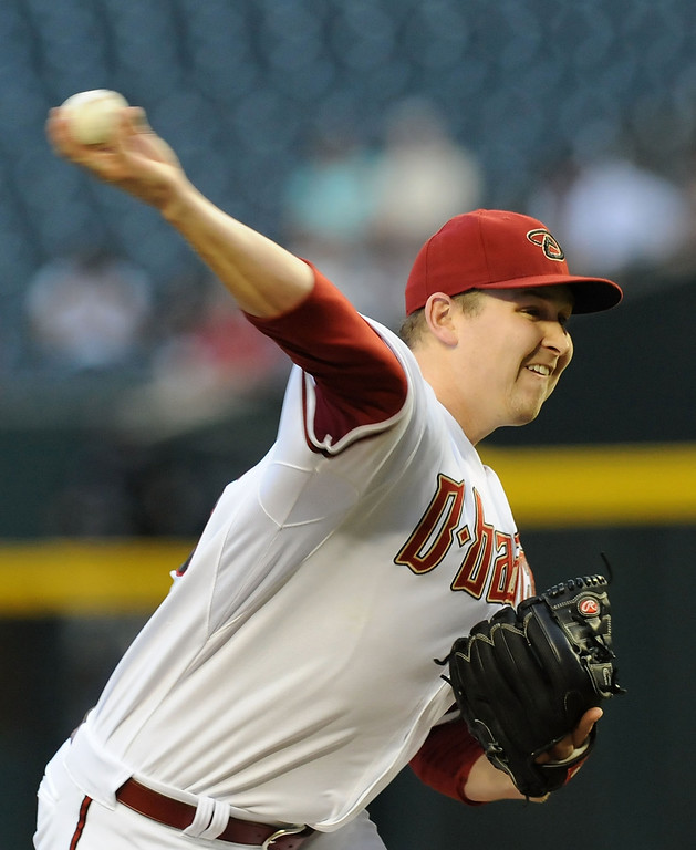 . PHOENIX, AZ - APRIL 25:  Trevor Cahill #35 of the Arizona Diamondbacks delivers a pitch in the first inning against the Colorado Rockies at Chase Field on April 25, 2013 in Phoenix, Arizona.  (Photo by Norm Hall/Getty Images)