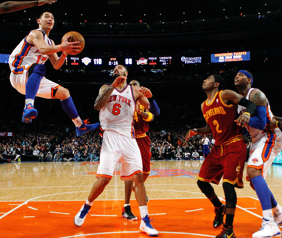 . New York Knicks guard Jeremy Lin (17) shoots a layup past center Tyson Chandler (6), Cleveland Cavaliers forward Antawn Jamison (4), guard Kyrie Irving (2) and Knicks forward Carmelo Anthony (7) during the second half of the Knicks\' 120-103 win in an NBA basketball game at New York\'s Madison Square Garden, Wednesday, Feb. 29, 2012. (AP Photo/Kathy Willens)