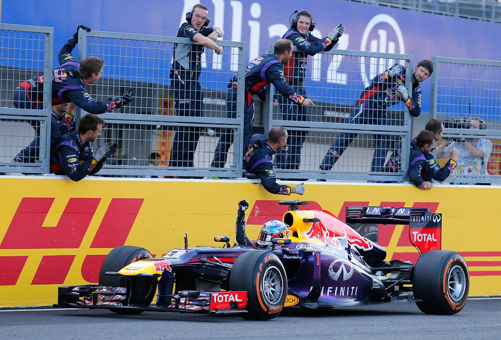 . Red Bull driver Sebastian Vettel of Germany celebrates along with his team after crossing the finish line to win the Japanese Formula One Grand Prix at the Suzuka circuit in Suzuka, Japan, Sunday, Oct.13, 2013.(AP Photo/Shuji Kajiyama, File)