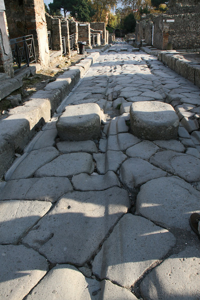 City street in the ancient ruins of Pompeii, Italy