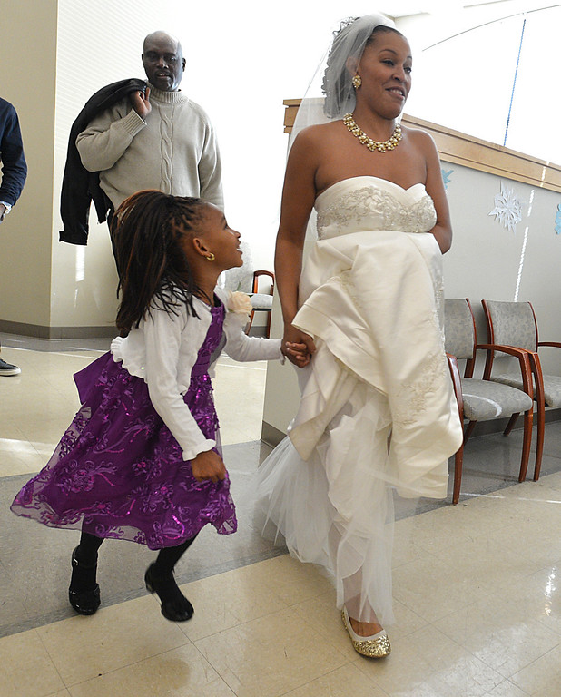 . Sherryce Couch of Antioch, walks out of the chapel at the Contra Costa County Clerk\'s building in Martinez with a family member at exactly 12:12 p.m. after her wedding ceremony with her new husband Shawn Couch of Antioch, in Martinez, Calif., on Wednesday Dec. 12, 2012.(Dan Rosenstrauch/Staff)