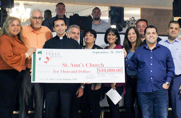 09/20/19 Wesley Bunnell | StaffrrThe General Ameglio ricotta night was held Friday September 20, 2019 with a dinner and presentation to the new Fr. Guisani scholarship fund as well to St. Ann Church. Presenting the check is Zeena Tawfik, L, Peter Delphino,, Father Israel Rivera,, Tony LorFice,Anna Penna Marchese, Antionette Campagne Fraello, Frank Maccarone, Joey Catanzaro & Lawrence Catanzaro.