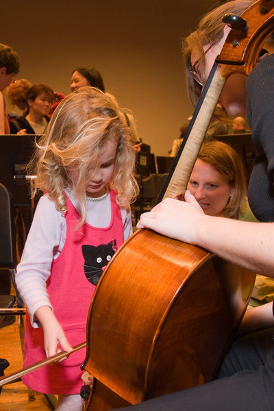 Rachel Kloss, cello, with child -- Hopkins Symphony Orchestra, March 2008