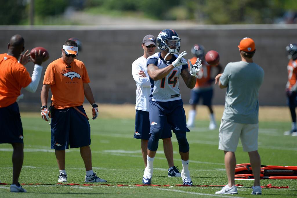 . Denver Broncos wide receiver Cody Latimer (14) runs through drills during OTAs June 10, 2014 at Dove Valley. (Photo by John Leyba/The Denver Post)